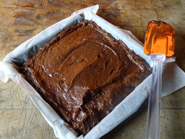 Putting the ganache layer on marzipan chocolate brownies | H is for Home