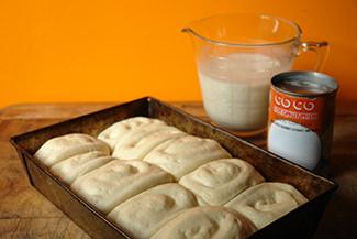 Risen panipopo dough in a rectangular baking tin | H is for Home