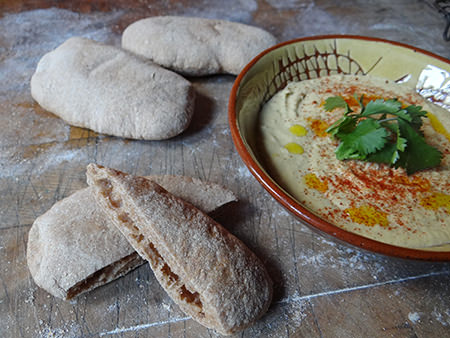 pitta sliced with bowl of hummus | H is for Home