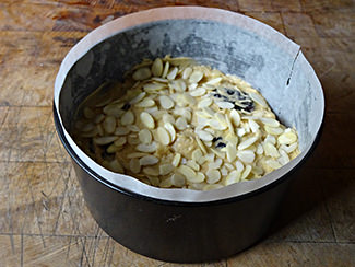 Prune and almond fruit cake mixture in cake tin   H is for Home