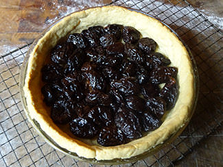 Armagnac-soaked Agen prunes lining a pastry case | H is for Home
