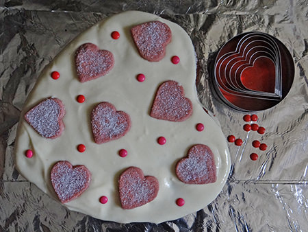 frosted & decorated red velvet cake with cup of tea | H is for Home