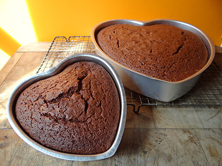 cooked red velvet cakes in heart-shaped cake tins | H is for Home
