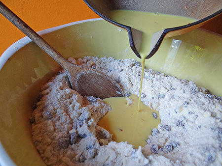 pouring saffron milk and yeast mixture on to dry mixture | @hisforhome