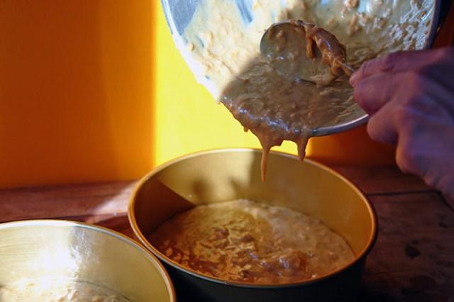 Pouring sweet potato cake batter into cake tins