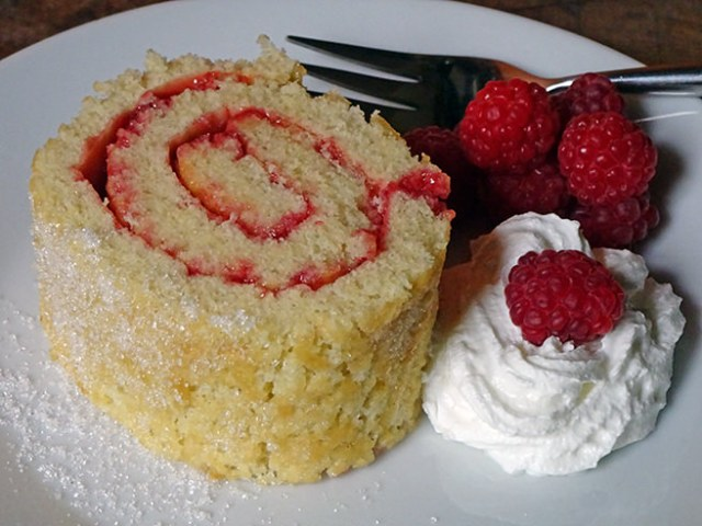 Slice of home-made Swiss roll with whipped cream and fresh raspberries | H is for Home