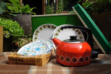 vintage orange enamel kettle and green patterned melamine plates