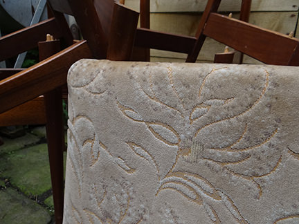 original cream coloured seat cover on a teak chair