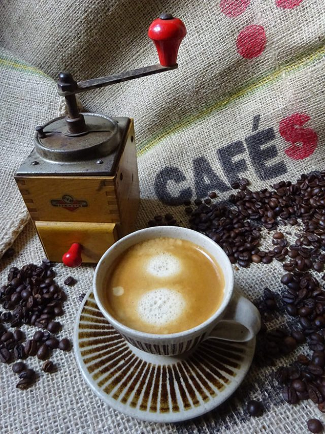 Cup of freshly brewed coffee, coffee beans and coffee grinder | H is for Home