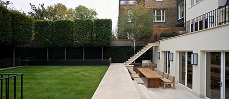 Garden with rectangular shaped pruned trees