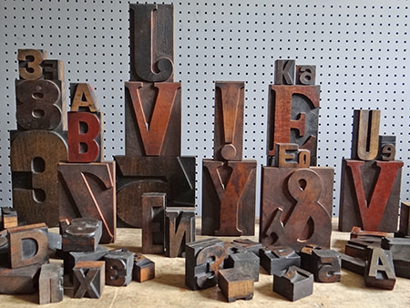 pile of wooden vintage printing blocks