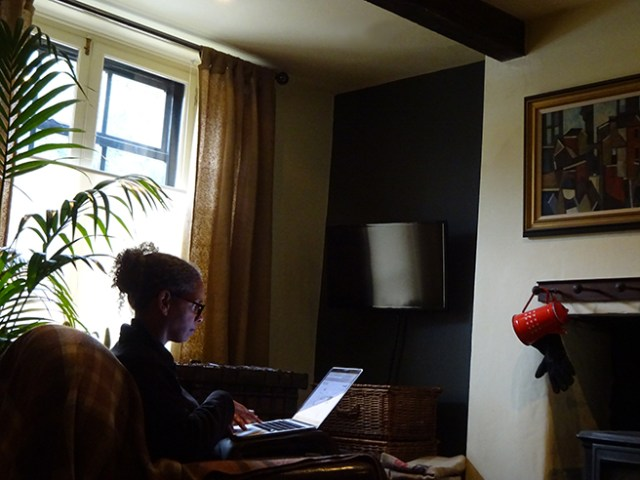 Adelle working next to the window in the sitting room | H is for Home