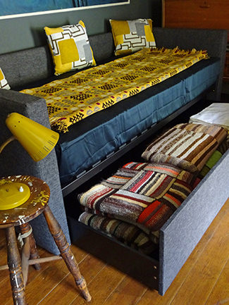 Frankie day bed with blankets stored in under-drawer | H is for Home