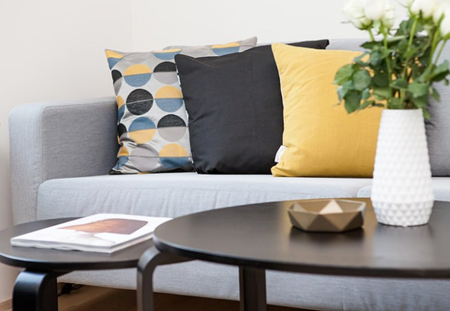 Grey sofa with contrasting cushions