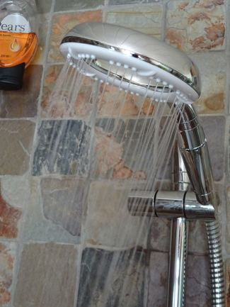 Ecocamel Orbit shower head turned on | H is for Home