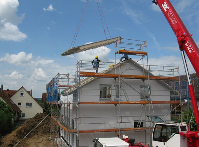 Installing a new roof with a crane
