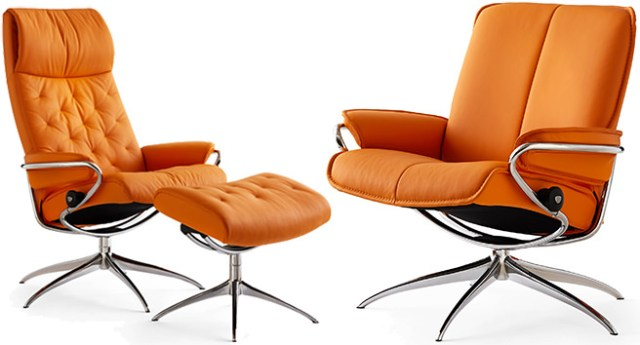 Orange upholstered reclining chairs
