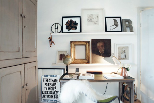Home office alcove decorated with artwork