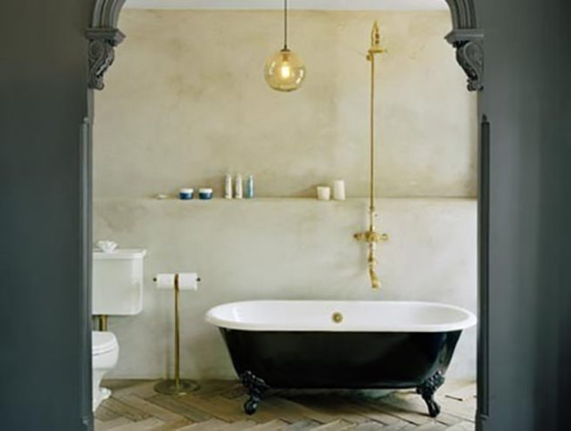 Bathroom with black roll top bath and brass accessories