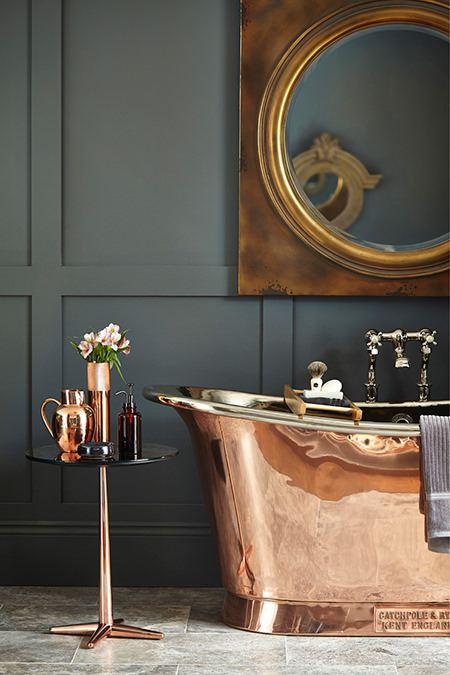 Copper roll top bath, mirror and accessories
