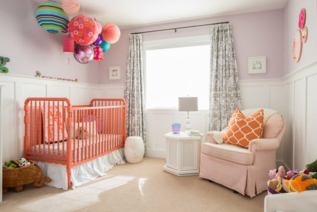 Child's nursery with coral painted cot bed