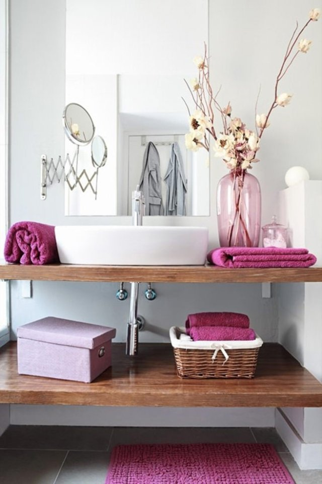 Bathroom sink console with dry rose coloured towels