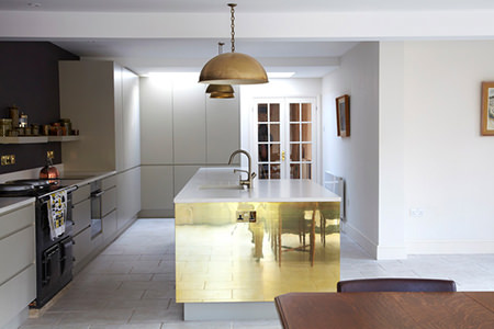Kitchen island with gold clad side panel