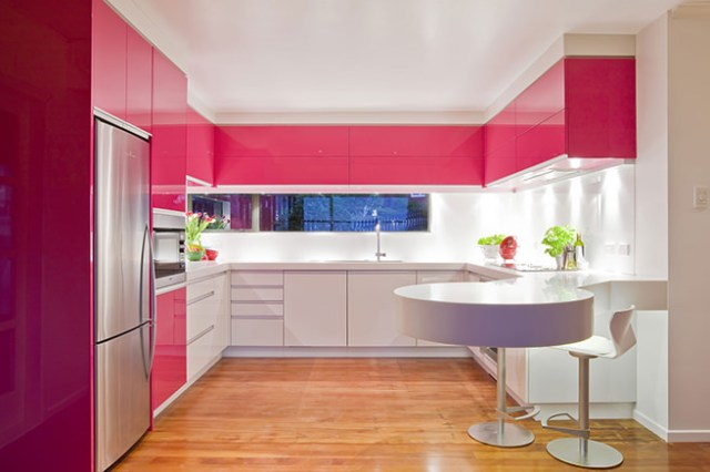 Glossy hibiscus pink and white fitted kitchen cabinets