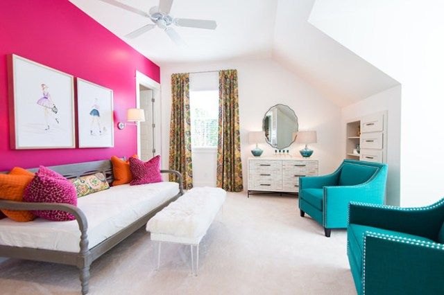 Sitting room decorated in hibiscus pink and white with turquoise upholstered armchairs