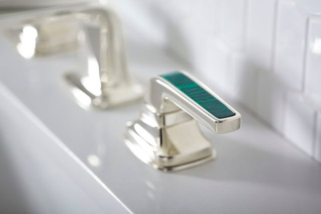 Silver coloured bath taps inset with malachite