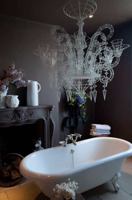 Dark grey painted bathroom with large feature wire chandelier