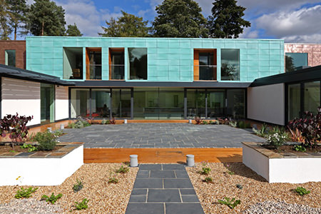 Modernist house with turquoise tiled exterior