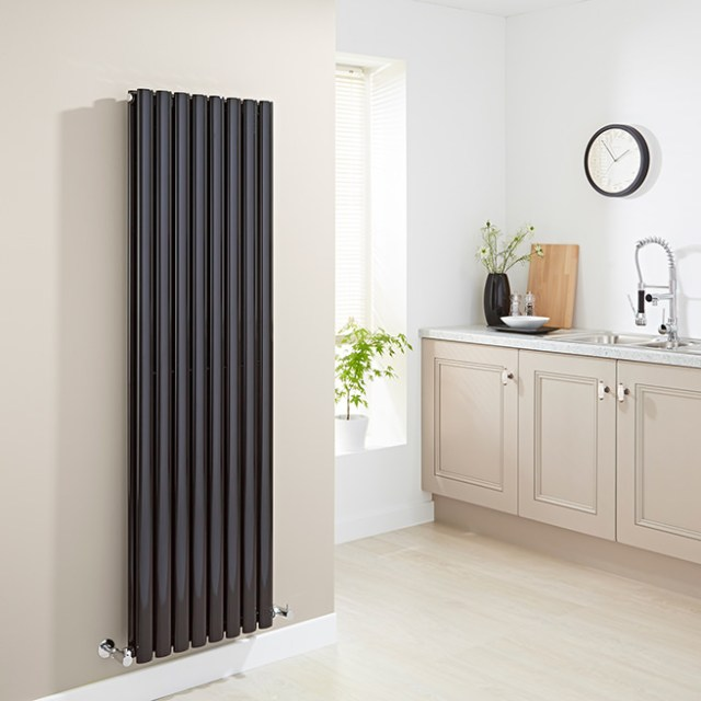 Kitchen with vertical wall radiator