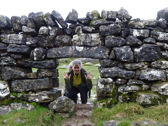 Adelle looking through a gap in a dry stone wall, Malham Cove, Yorkshire Dales | H is for Home