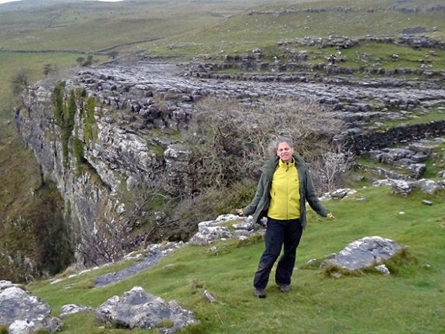 Adelle braving the wind, Malham Cove, Yorkshire Dales | H is for Home