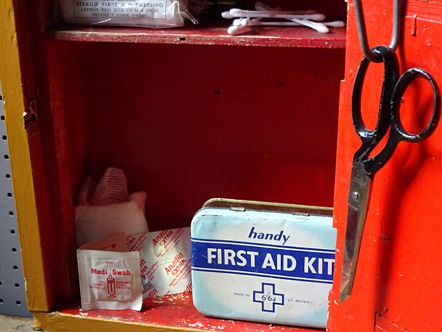 Vintage mirror-fronted cabinet with vintage first aid kit accessories inside   H is for Home