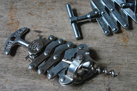 pair of vintage metal corkscrews | H is for Home