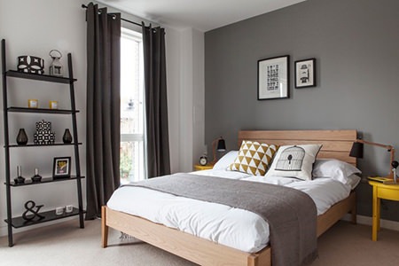 grey and yellow decorated bedroom