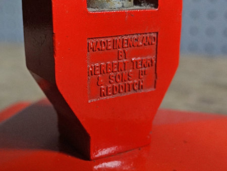 Detailed view showing maker's mark on an orange original vintage Anglepoise lamp