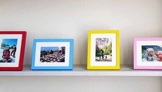 Row of portrait and landscape photos framed in 'Colour Bloc' frames from Now Frame It