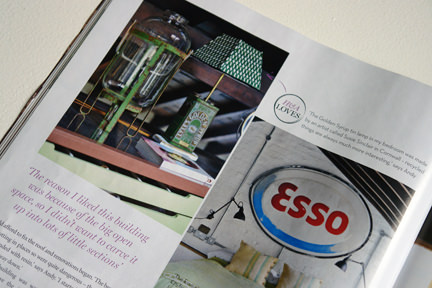 page from the October 2013 issue of Homes & Antiques magazine showing a vintage Esso illuminated advertising sign