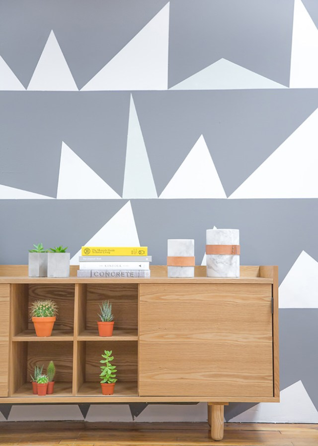 Grey and white feature wall decorated with triangles