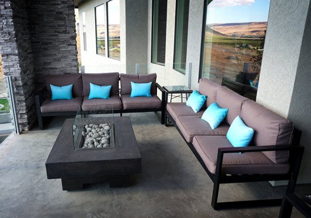 Dark brown patio seating with turquoise cushions