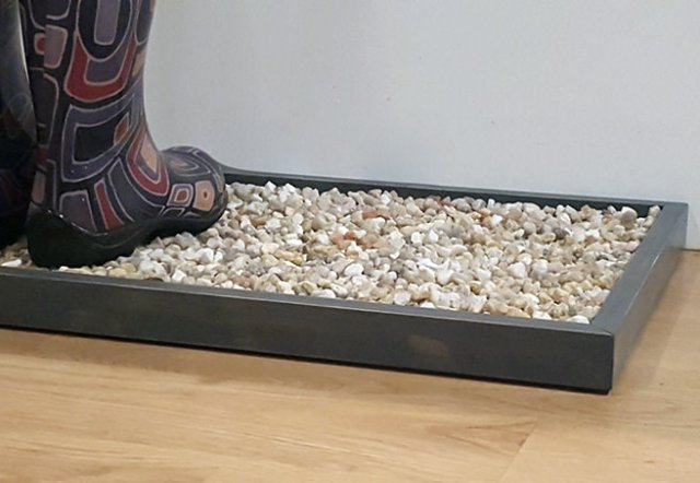 Boot pebble tray
