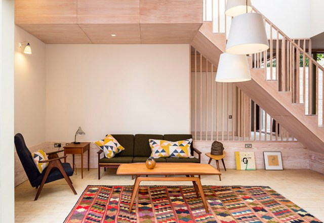 Large colourful rug in a mid-century modern inspired sitting room