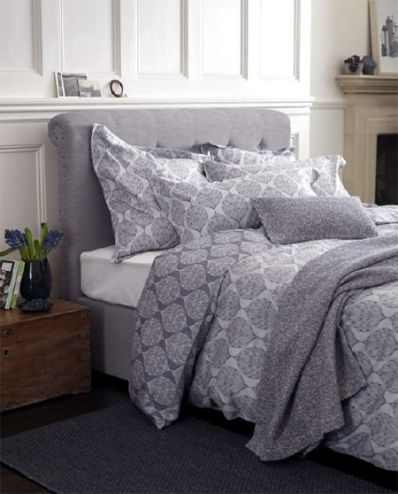 Bed made with Secret Linen Store ''Artichoke' pattern bedding in navy