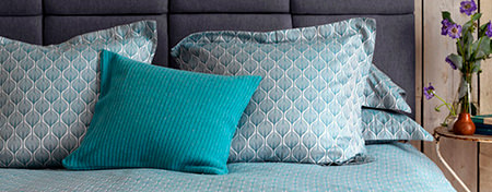 Bed made with Secret Linen Store ''Teasels' pattern bedding in teal