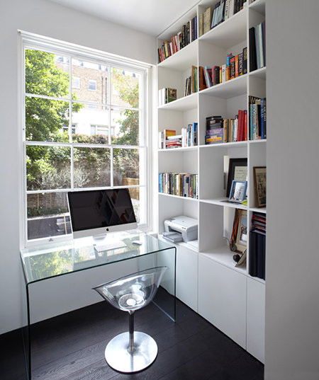 Contemporary home office with clear desk and chair