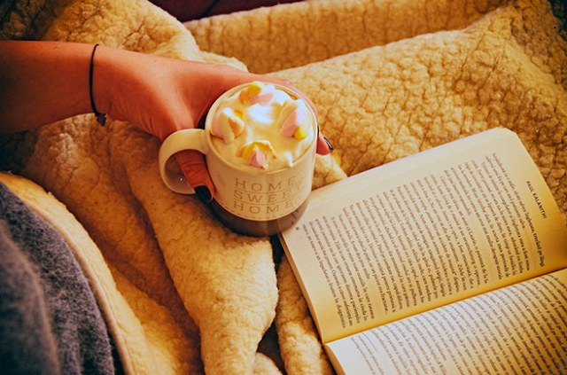 Reading a book with a hot chocolate