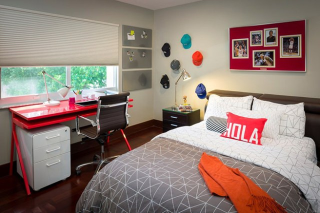 Teen-aged boy's bedroom with basketball memorabilia on the wall
